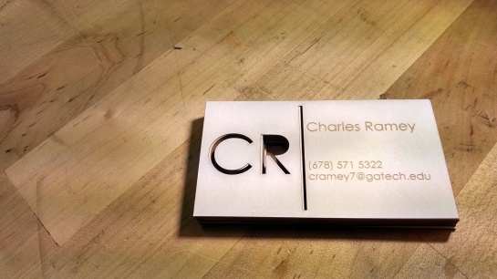 Lasercut business cards made from cardstock.